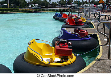 Bumper Boats at Rest - A group of colorful bumper boats from...