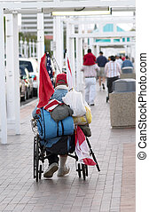 Homeless Vet - A homeless veteran in a wheelchair with a...