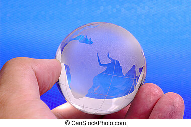 The World in Your Hand - A Hand Holding a Glass Globe