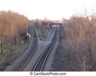 autumn train tracks - Two sets of train tracks diverge....