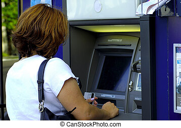 ATM - Woman Using a ATM Machine.
