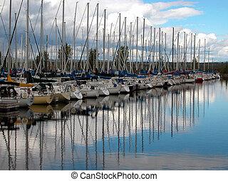 moorings - sailboats moored at a yacht club