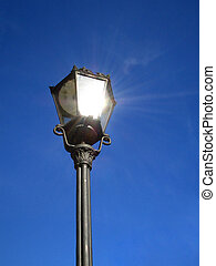 Street Light - an old street light in the city reflecting...