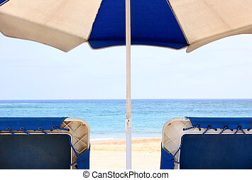 Beach Relaxation - View from behind beach umbt¡rella and...
