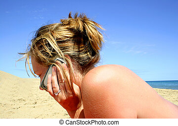 Beach Phone Call - Woman using mobile phone on the beach