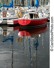 red boat - sailboat reflections at a yacht club