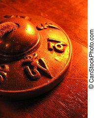 tibetan bell - detail of an tibetan bell, showing the...