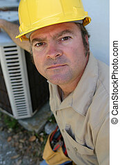 Serious AC Repairman - An air conditioning repairman looking...