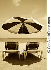 Retro Beach - Beach umbrella and loungers in sepia tones