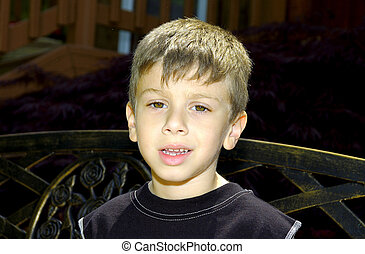 Young Boy - Photo of Young Boy Sitting On a Bench.