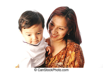 mother and son - hispanic mother smiling at her son