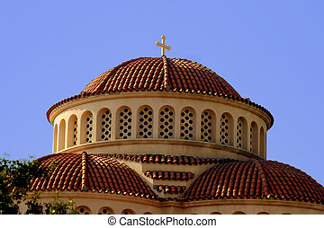 Church - Cypriot church roof with red tiles against a blue...