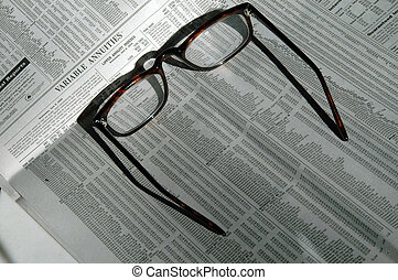 glasses - variable annuities stock charts with reading...