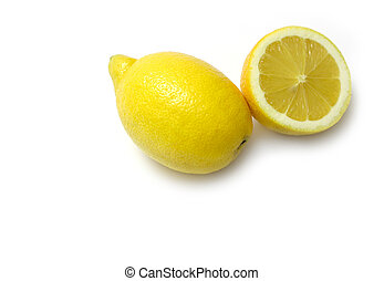 Lemon and Half - One cut and one whole lemon on white...