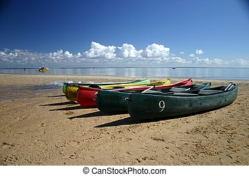 Canoes on Beach - Coloured Canoes on Beach