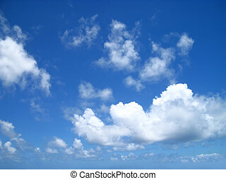 Drifting Clouds - Puffy clouds drifting in on a sunny day on...