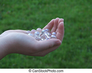 Handful of Promises - Young woman's hand with shallow DOF,...
