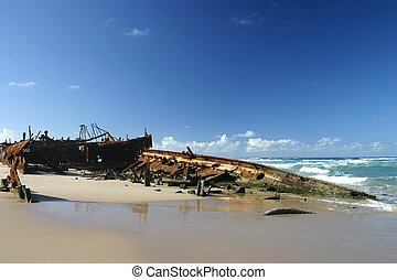 Shipwreck in surf - Shipwreck of the Maheno in the surf at...