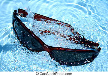 Sunglasses in water - Summer fresh image of sunglasses in...