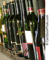 Wine Bottles - A row of wine bottles in dark colors lined up...