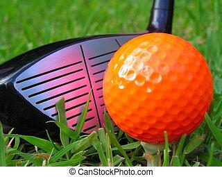 Golf ball on a tee with a club