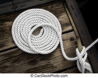 Boater's Art - white boat rope on dock