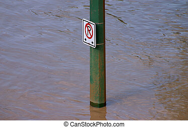 Sign post in the middle of a flood