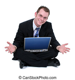 Business Man Sitting On Floor With Laptop Hands Out. Shot in...