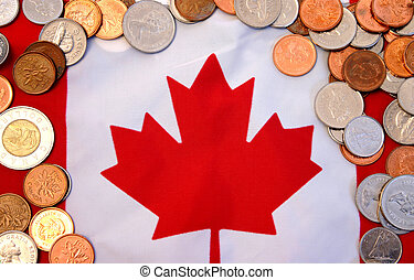 Canadian economy - Coins against Canadian flag