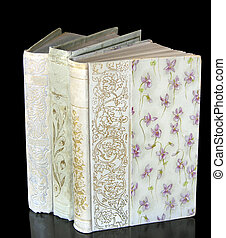 Memories (2) - Three white, hard cover 100 year old novels....