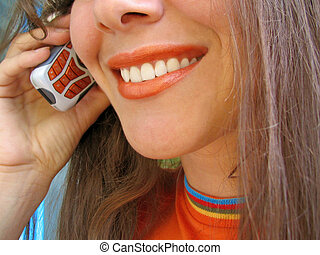 Mobile woman - A smiling Woman talks by a mobile phone