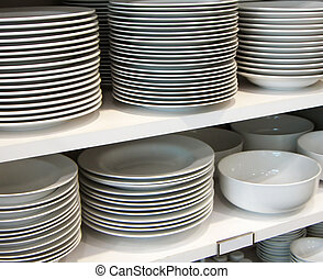 white dishes on retail shelf