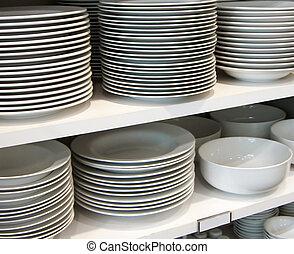 white dishes on retail shelf