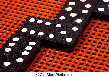 Dominoes On Orange and Black Background