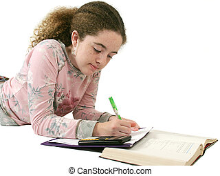 Student Homework - A teenaged girl doing her homework....