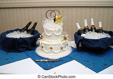 Wedding Table and Cake - A table with a wedding cake and two...