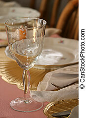 Elegant Table - A crystal wineglass at nicely set table.