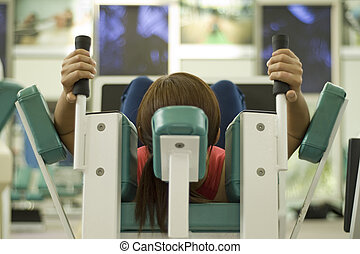 Working Out - A female works out in a gym. Picture has...