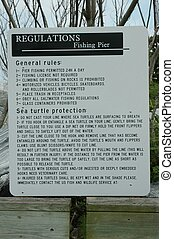 Pier Regulations - Photographed at a local fishing pier...