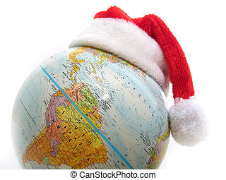 Merry Christmas - Santa's hat on top of a globe.