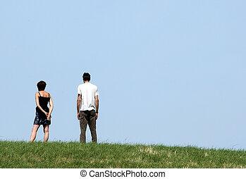 couple - Couple on a dike near the sea