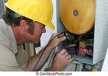 AC Repairman Working - An air conditioning repairman,...