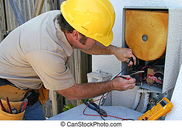 AC Repairman 2 - An AC tech working on a heat recovery unit
