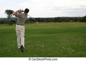 Hitting the bal - Player hitting a golf ball down the...