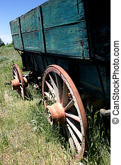 old wagon - a historic old wagon in rural wyoming