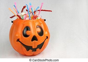 Pumpkin With Candy - A Halloween pumpkin bucket brimming