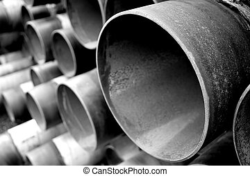 steel pipes in bw - a set of large steel pipes in black and...