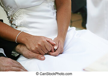 holding hands - bride and groom holding hands at wedding...