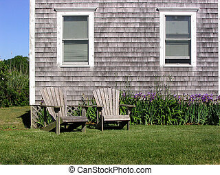 Cape Cod Chairs - a pair of weathered chairs outside a Cape...