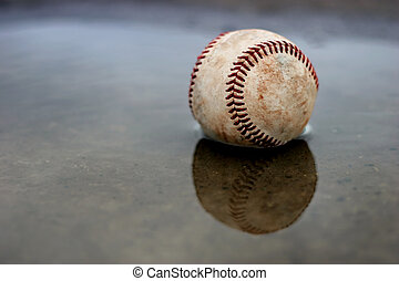home run - used baseball comes to rest in a puddle outside...